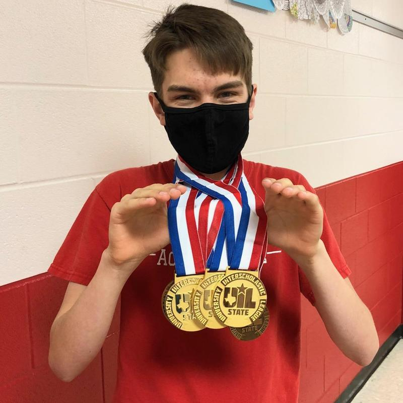 Philip Templeman with UIL Academic gold medals