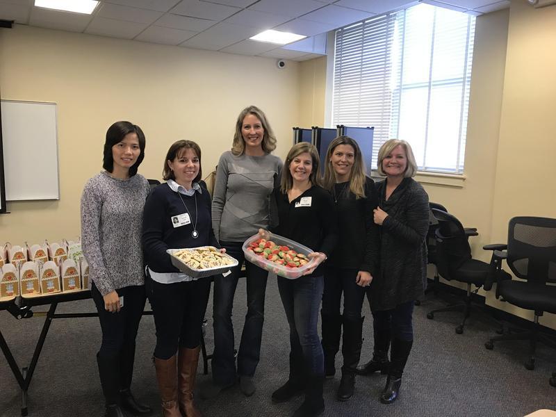 PTO Members Holding Cookies