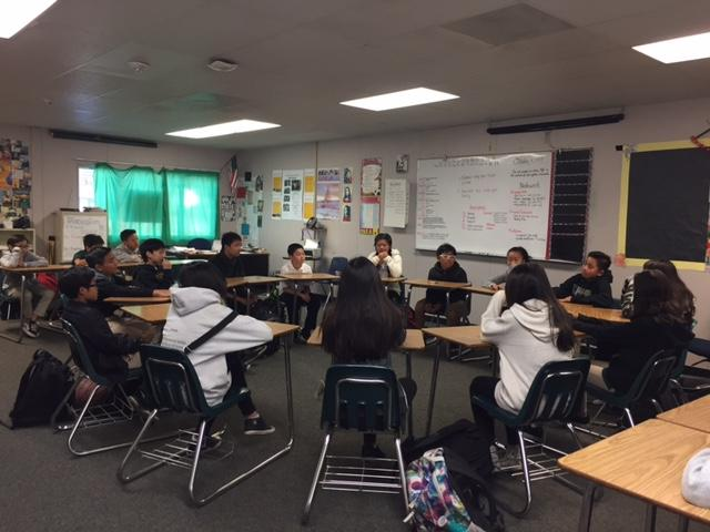 Students discuss literature in Socratic Seminars.