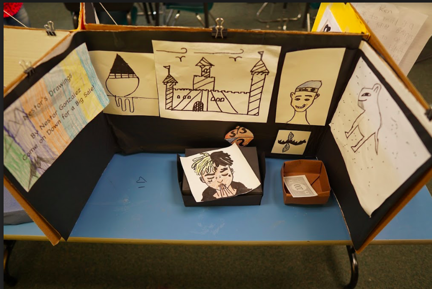student's artwork drawings on display