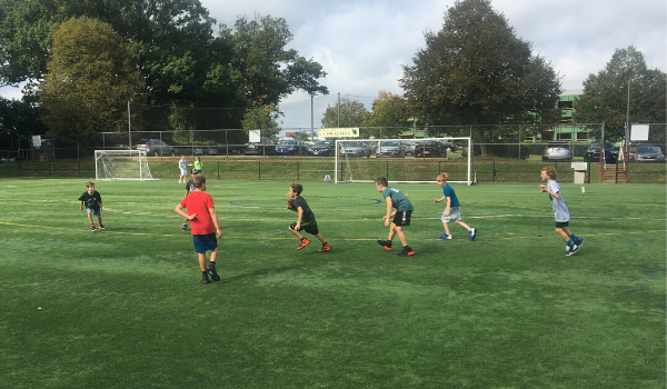 Lower School students playing on the turf fields.