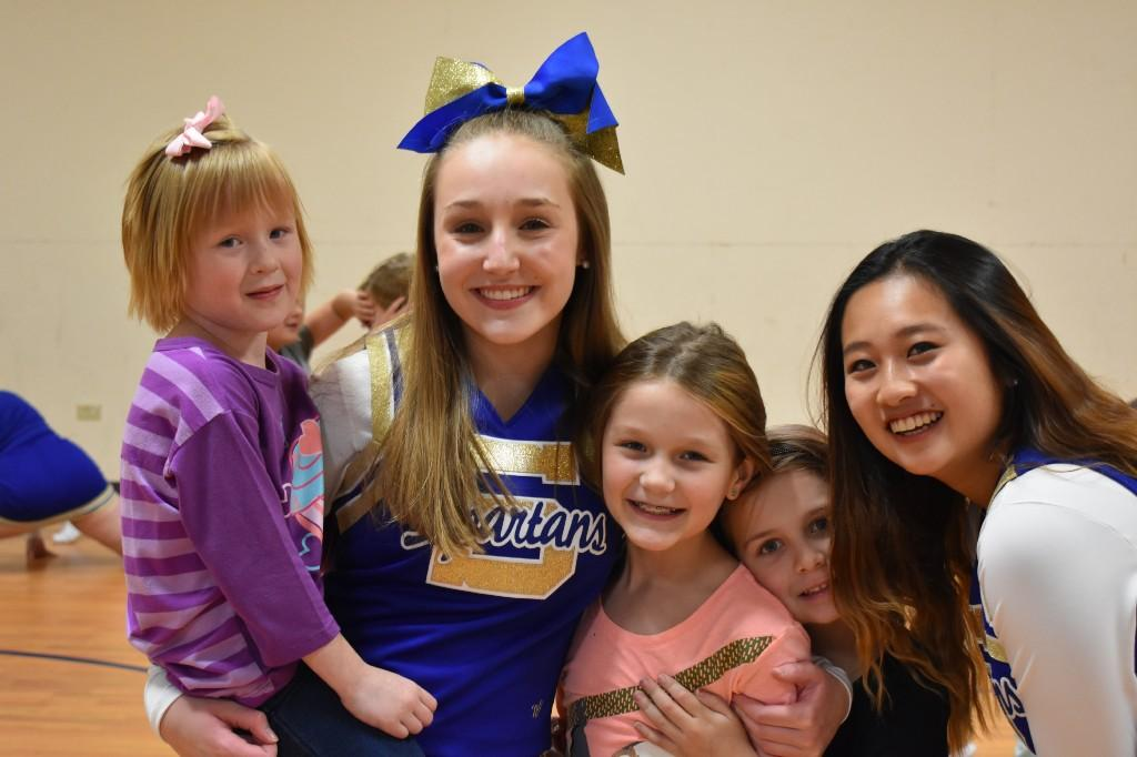 Fun at cheer camp - High Schoolers teach the littles routines.