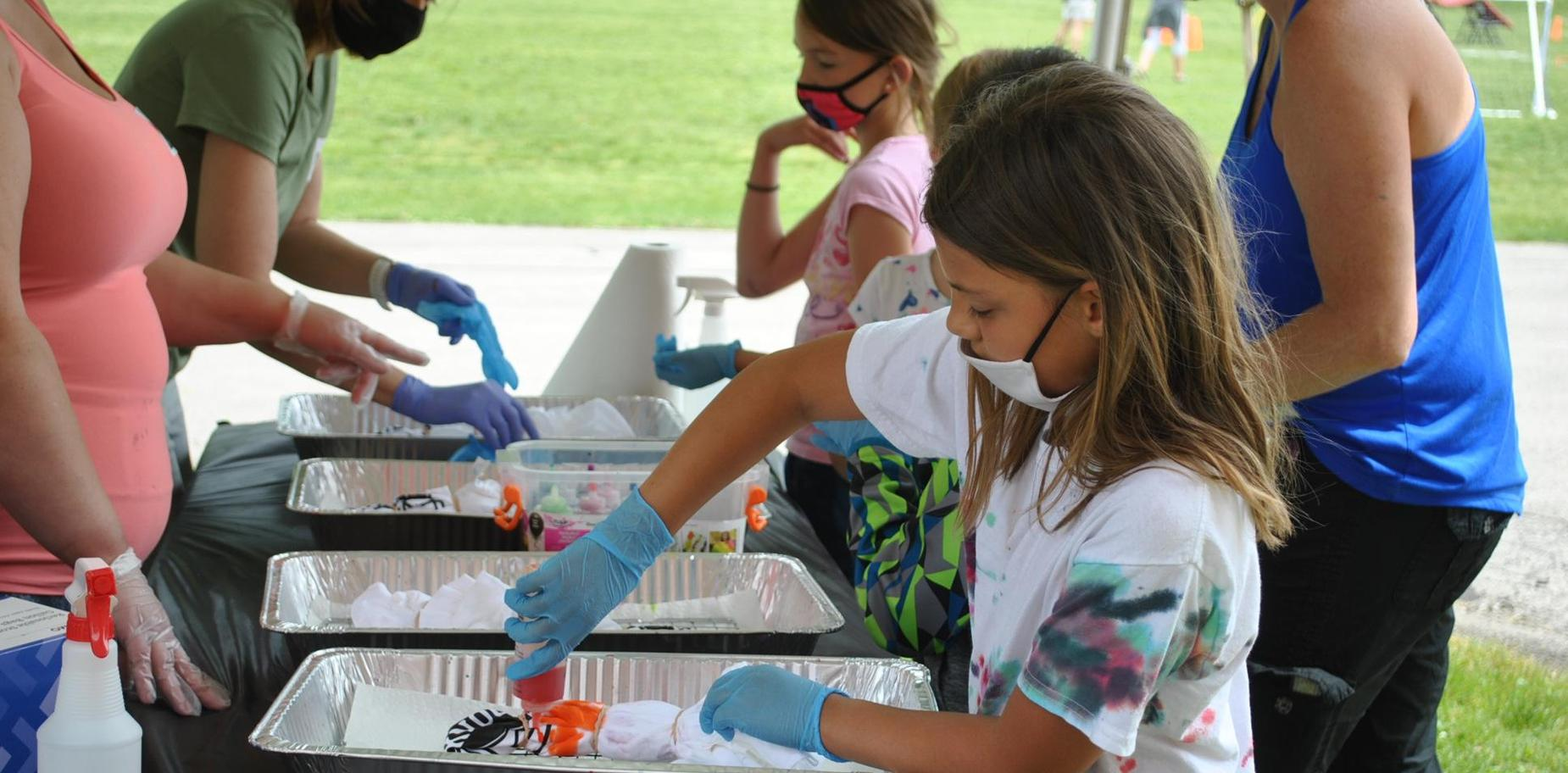 students making tie-dyed shirts