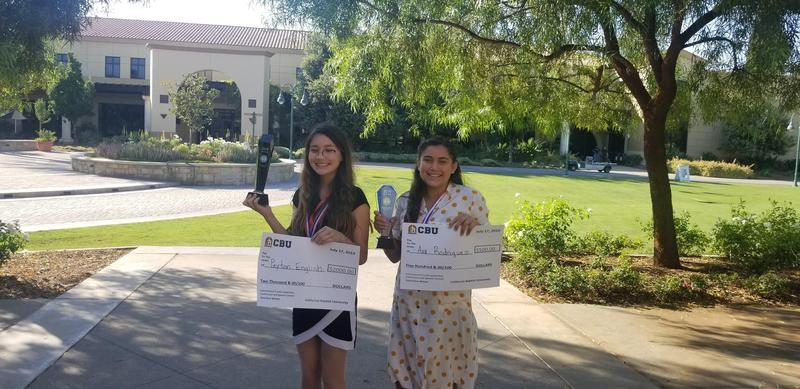 Peyton English & Ava Rodriguez Posing with their trophies and winners checks