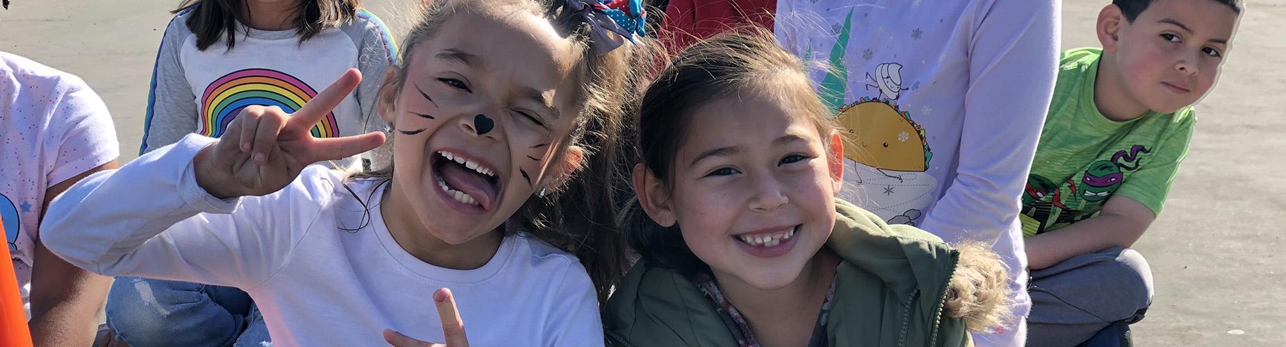Children smiling outside