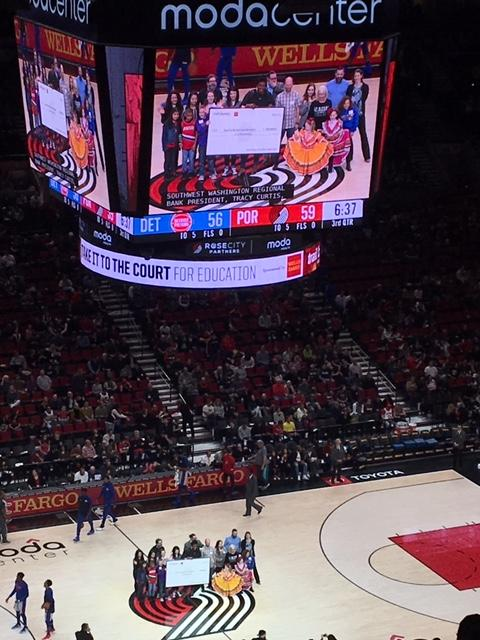 View of the video board showing the students on the Blazers court
