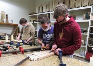 Students work on making the cutting boards.