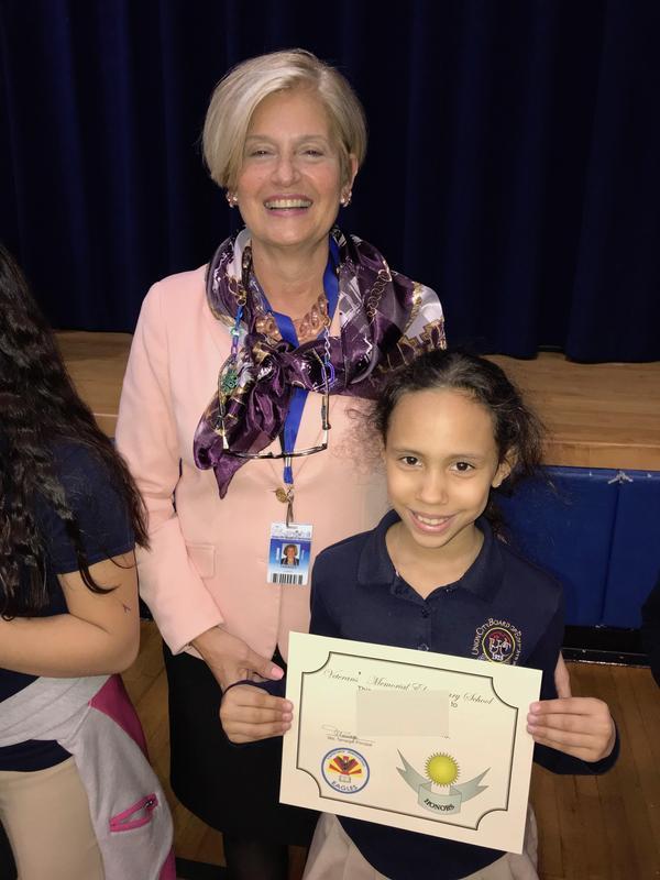 Principal Tamargo with Honors recipient