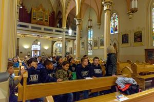 students sitting in a cathedral