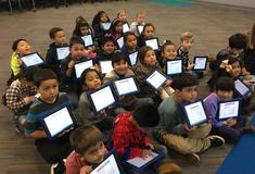 Students holding iPads.