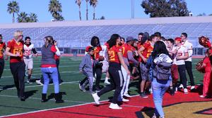 The particapants had a great time scoring touch downs with the Hemet High School football team.
