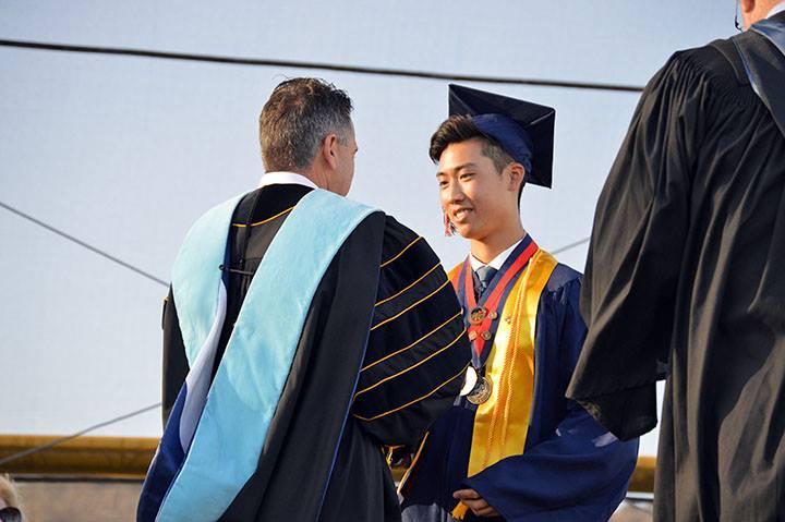 Dr Domene congratulates a graduate
