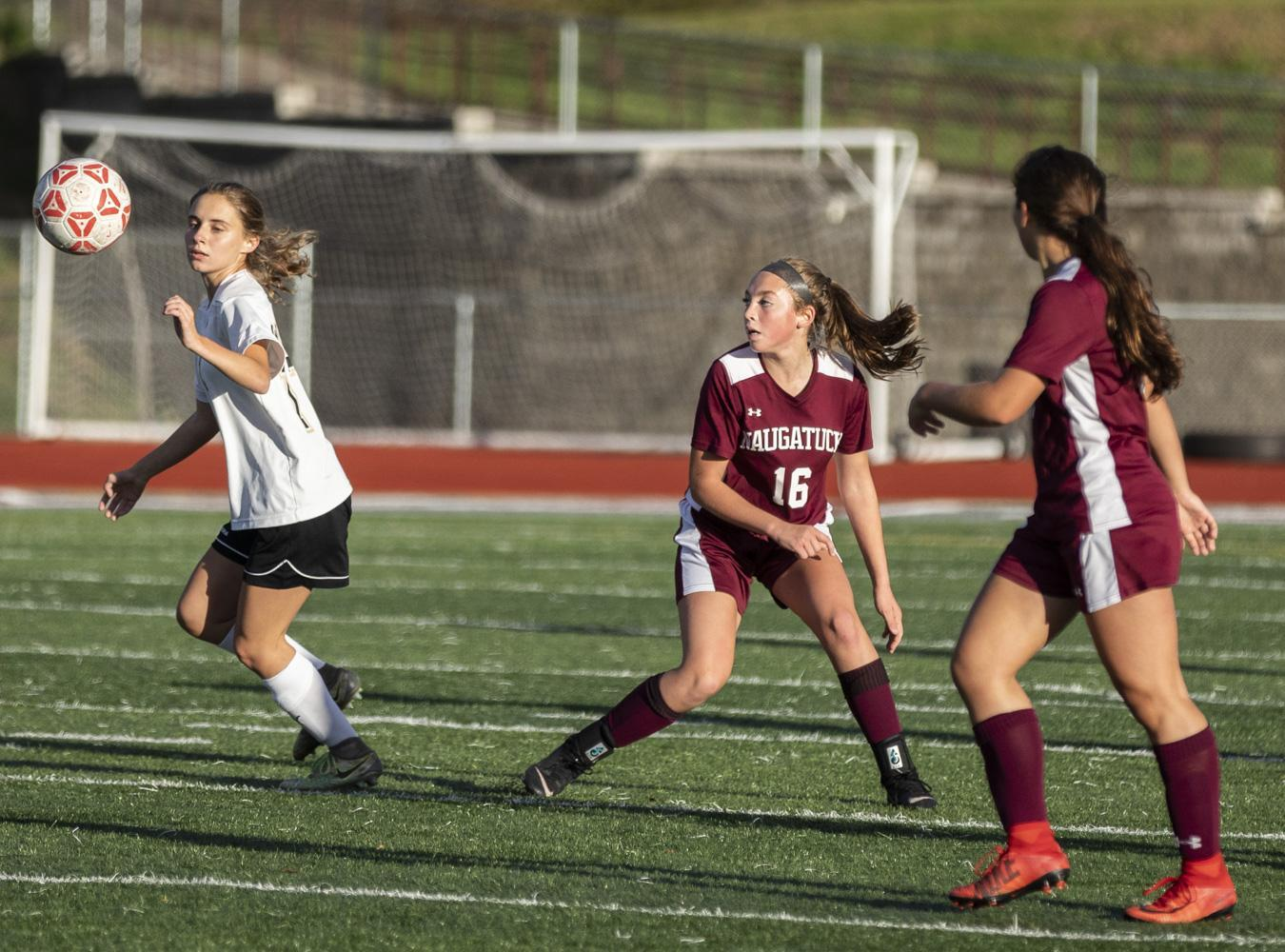 Naugatuck high school girls soccer players in game against Woodland at Veterans Field