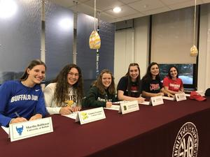 6 students signing