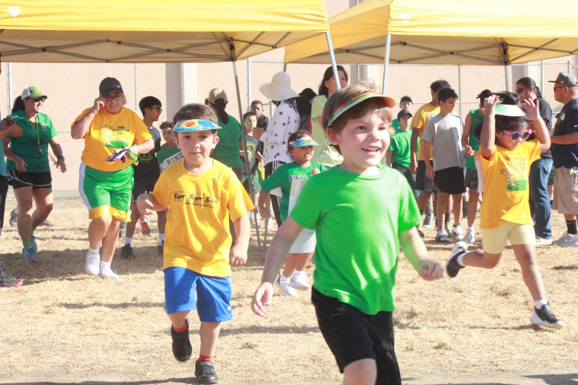 At our annual Jog-a-Thon, students run around the field to raise money for our school.