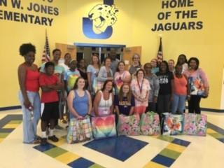 Picture of teachers receiving their back to school supply donations from the community