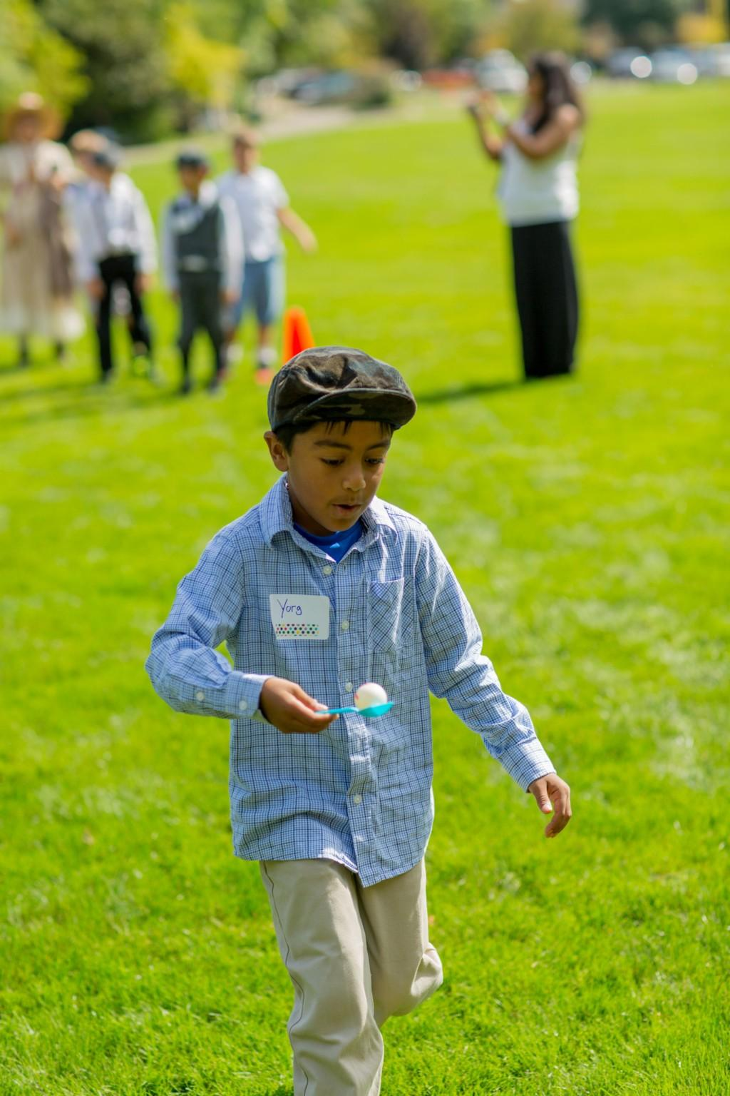 Boy playing egg race