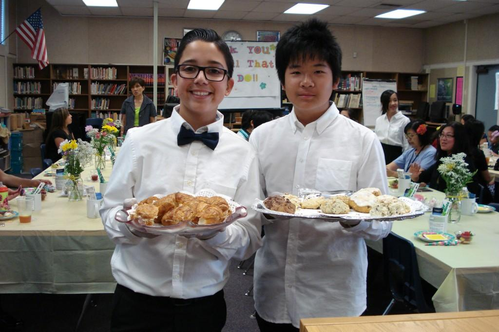 Marguerita students giving out pastries during the Volunteer Tea