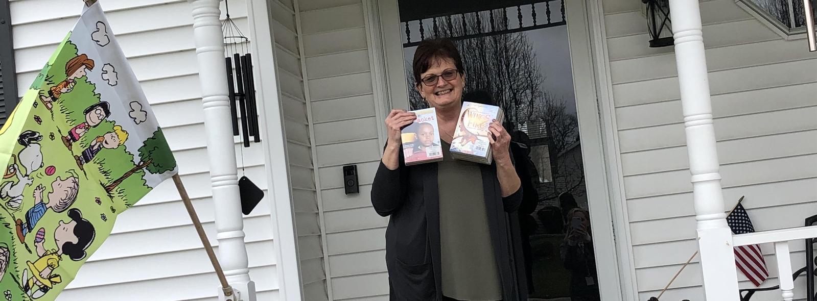 Mrs. David delivers books
