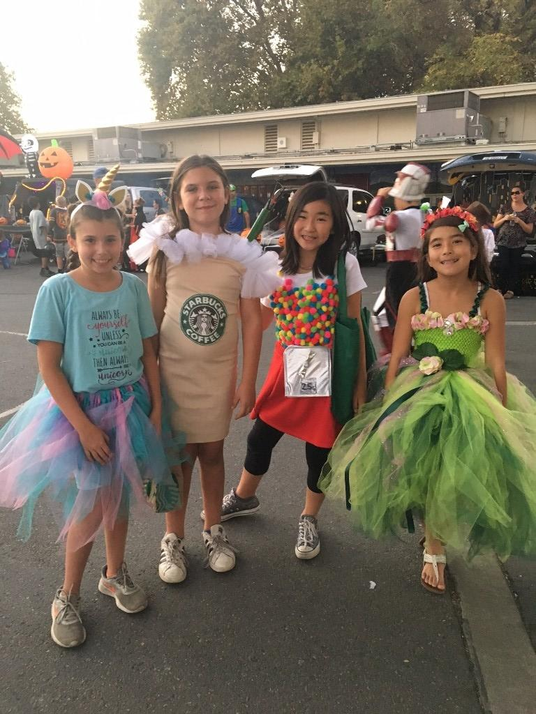 girls dressed as unicorn, frappacino, bubble gum machine and fairy