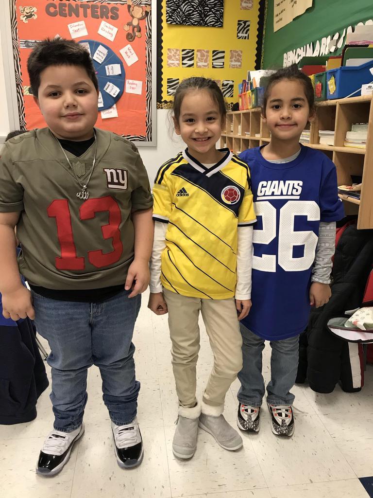 three kids showing team pride