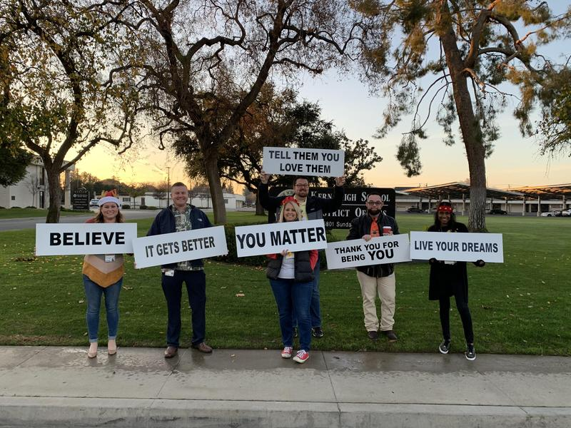 KHSD employees held signs with positive messages on them early Friday morning.