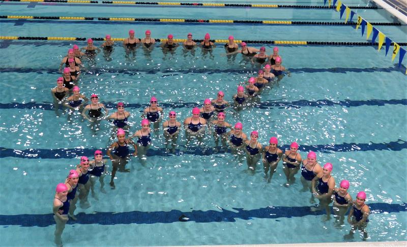 TK-DK-Hastings swimmers along with their opponent Wayland team members created the Cancer symbol after their cancer awareness swim meet Thursday.