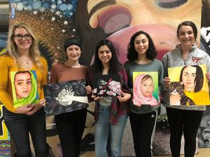 Pictured holding artwork is Katelyn Montgomery, Gracie Calla, Jill Rimer, Carly Huff, Samantha Schwamberger