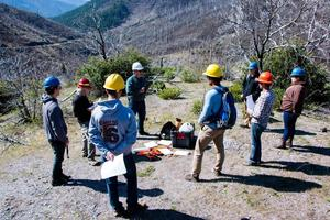 Students Discussing Restoration Project on Moonlight Fire