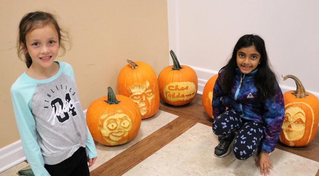 Two McKinley 3rd graders pose in front of Halloween pumpkins during a visit to Westfield Town Hall.