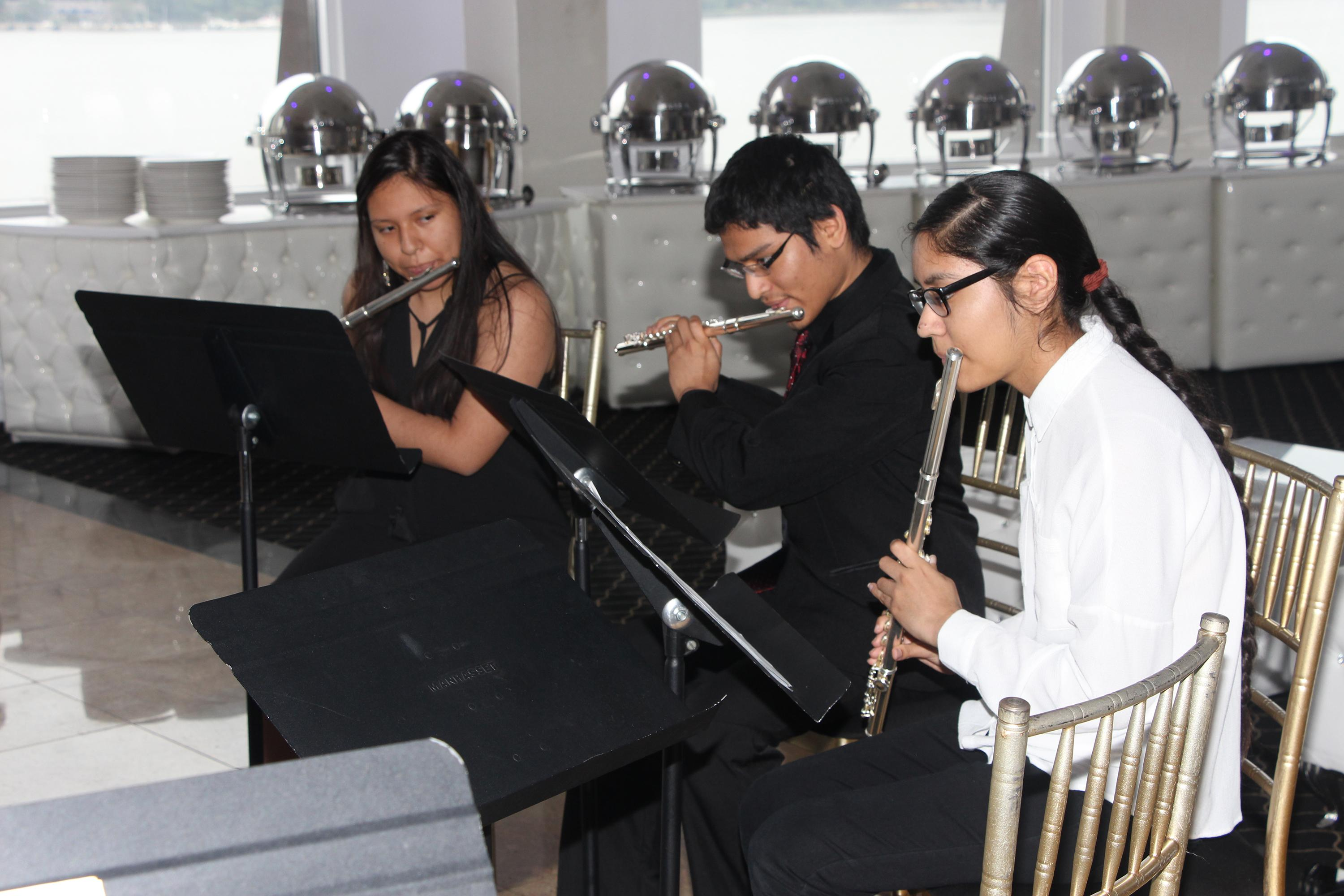 UC students playing the flute