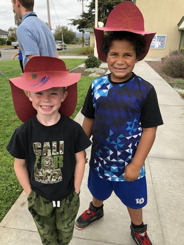2 boys in fire helmets