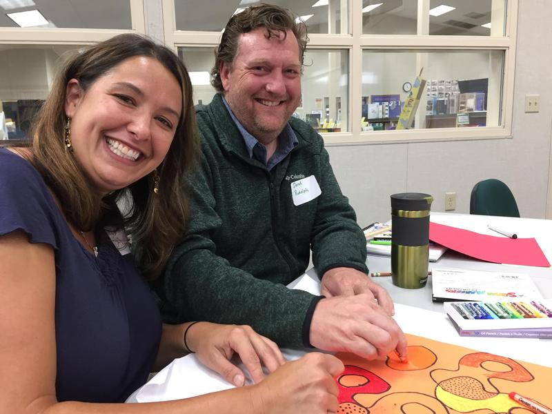 Two teachers collaborating on an art project