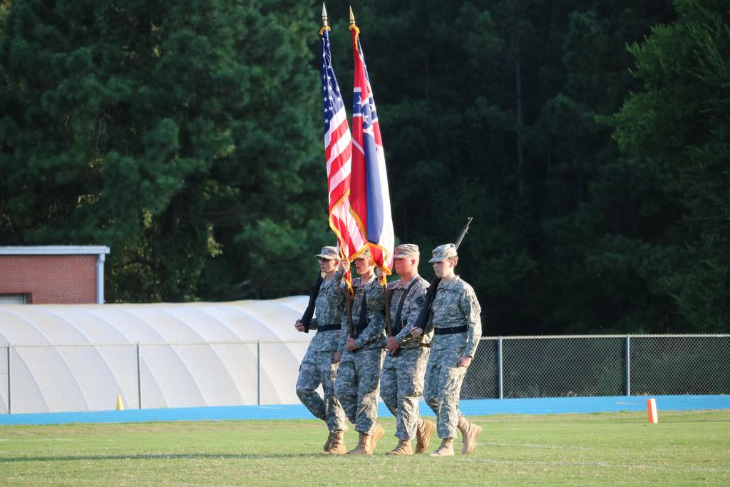 JROTC color guard presenting colors at football game