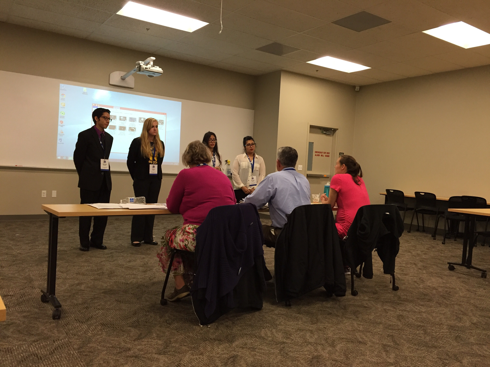 Students presenting in front of judges