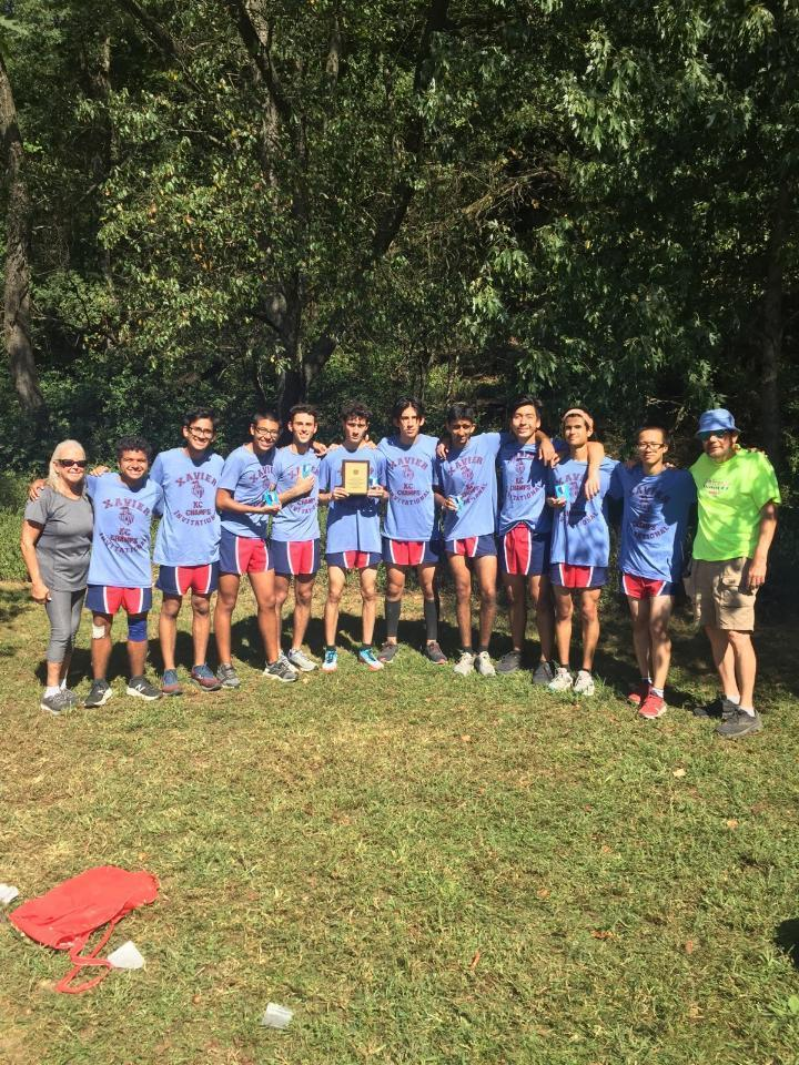 Varsity boys XC team winning the Xavier Invitational at Van Cortlandt Park in Bronx, New York on September 21st. Team is pictured wearing their Championship Blue T shirts.