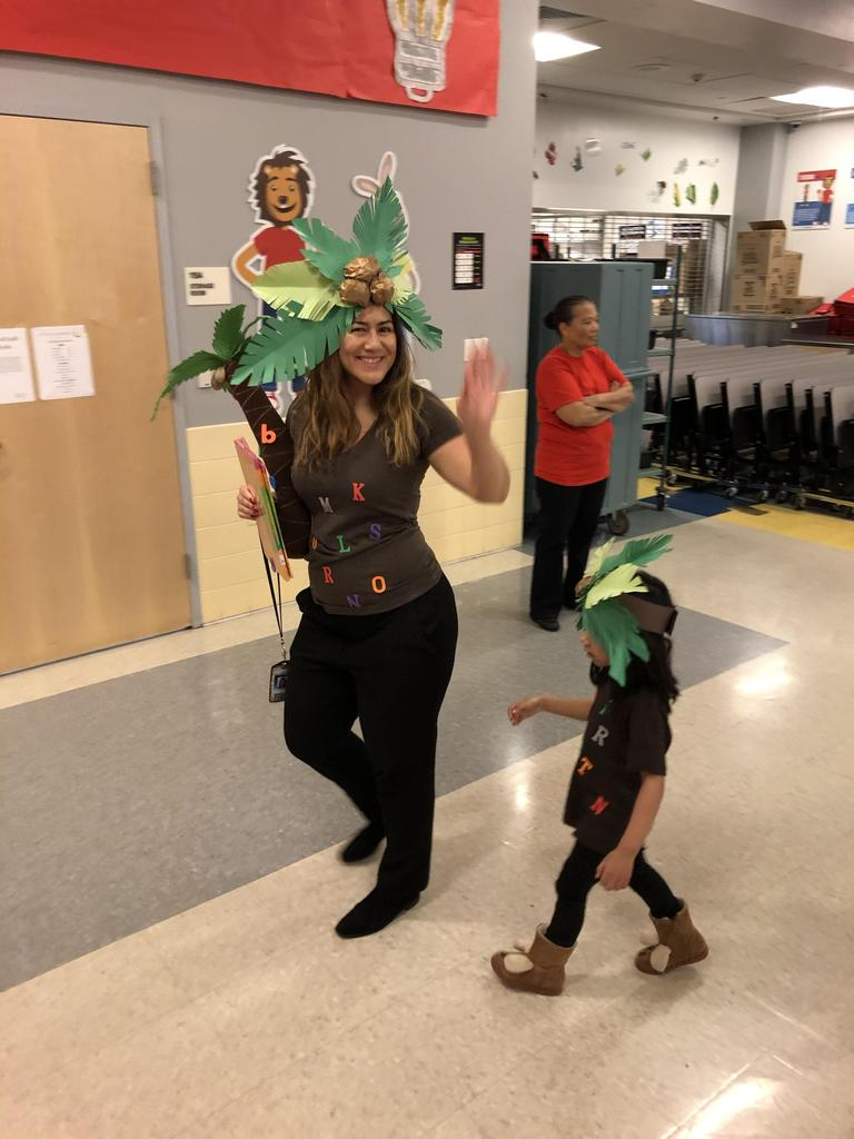 teacher and student dressed as letters palm trees