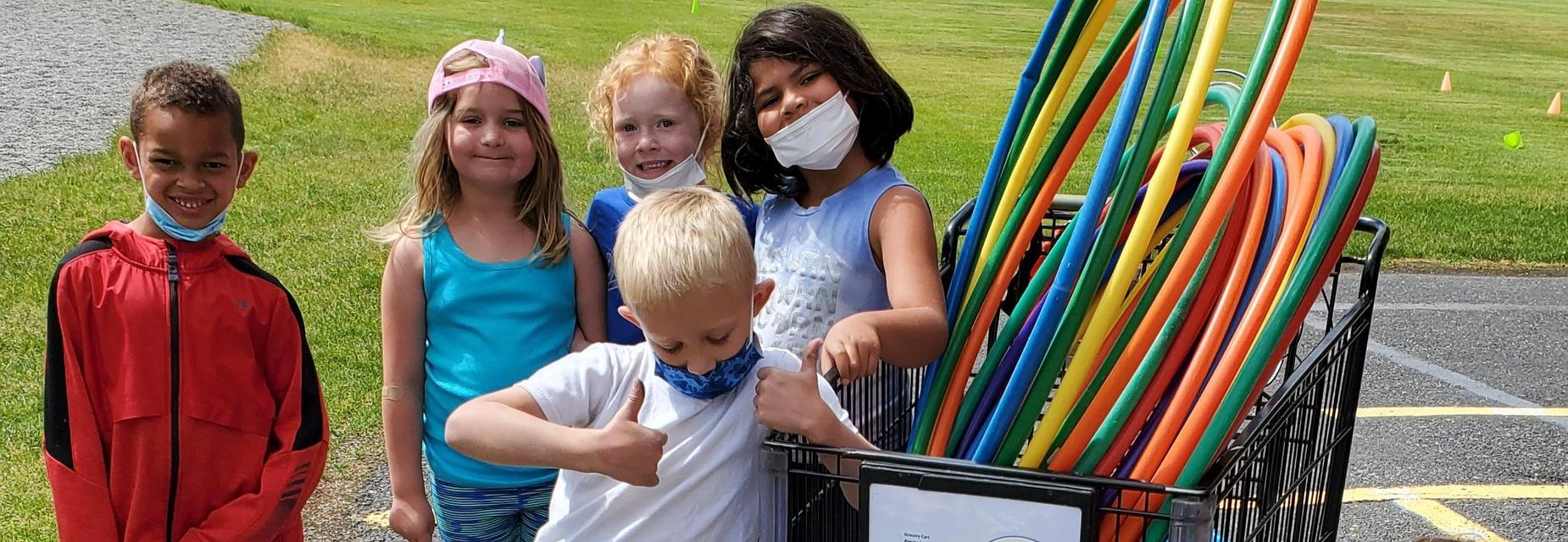Students with recess equipment
