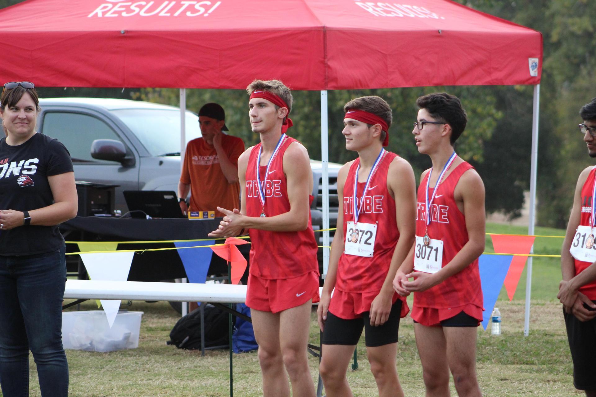 Michael Eggert, Andrew Castaneda, and Ryan Diaz after receiving medals