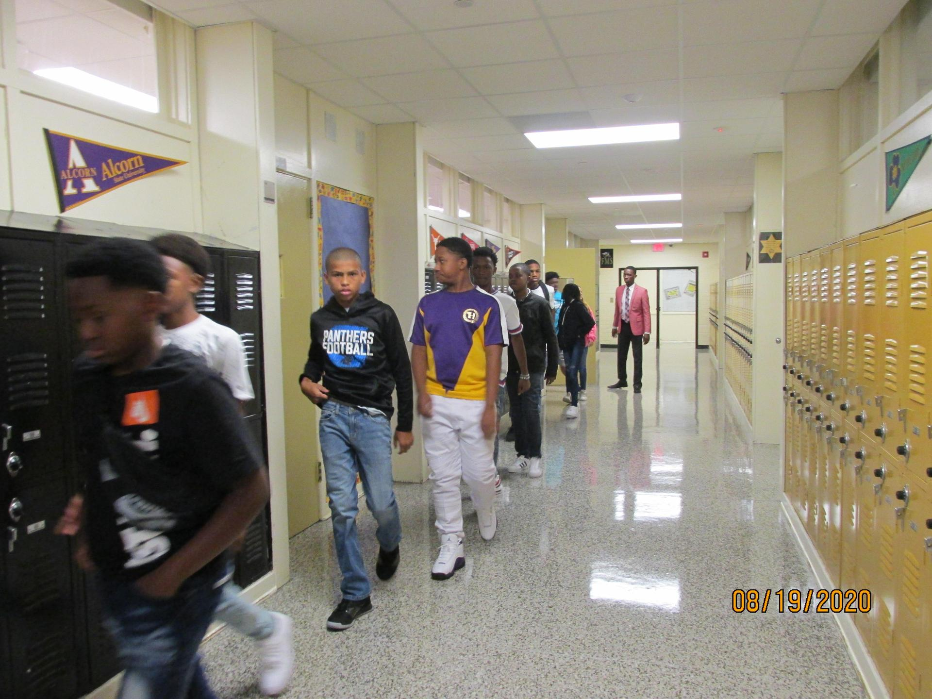 Students walking the hall in line