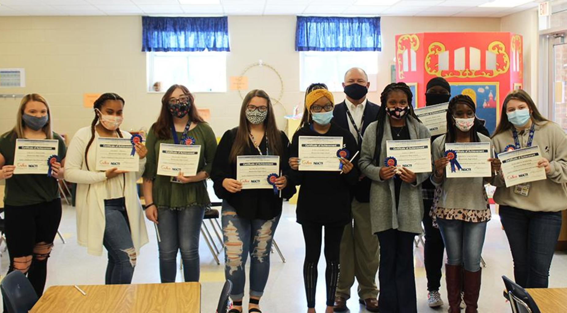 Dr. Scott Spence poses with student-teachers of the Pint Pirates program.
