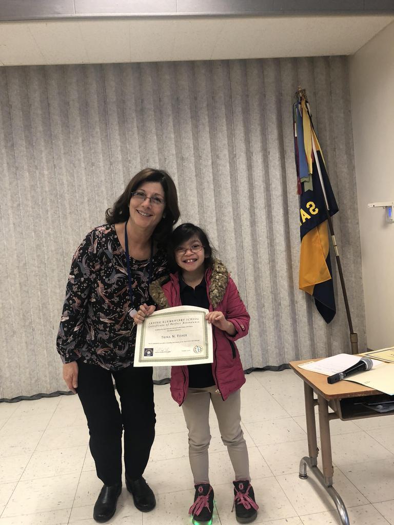 Debbie Reyburn, SDC teacher poses with award winner (student)