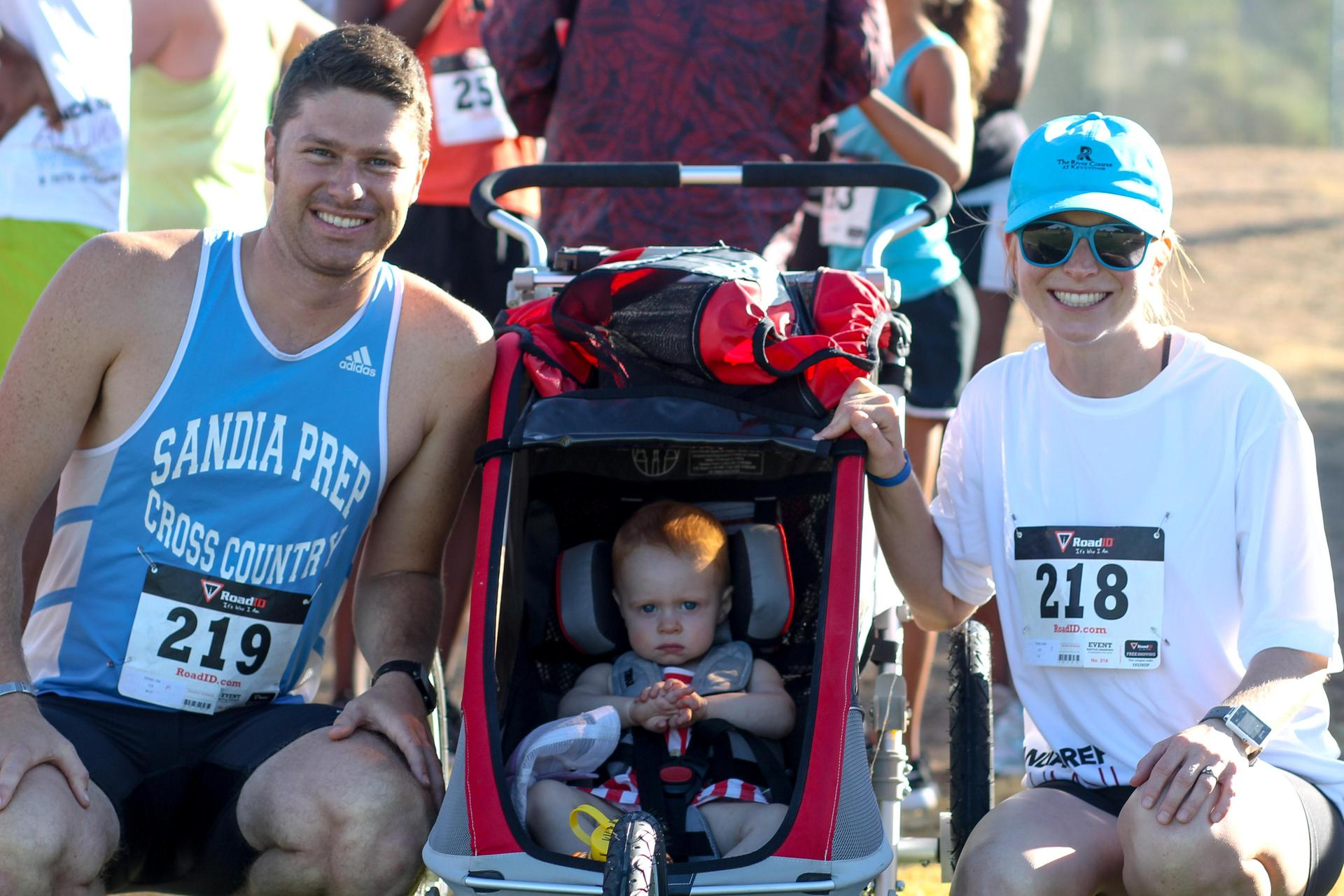 Family with baby smile at 5K run