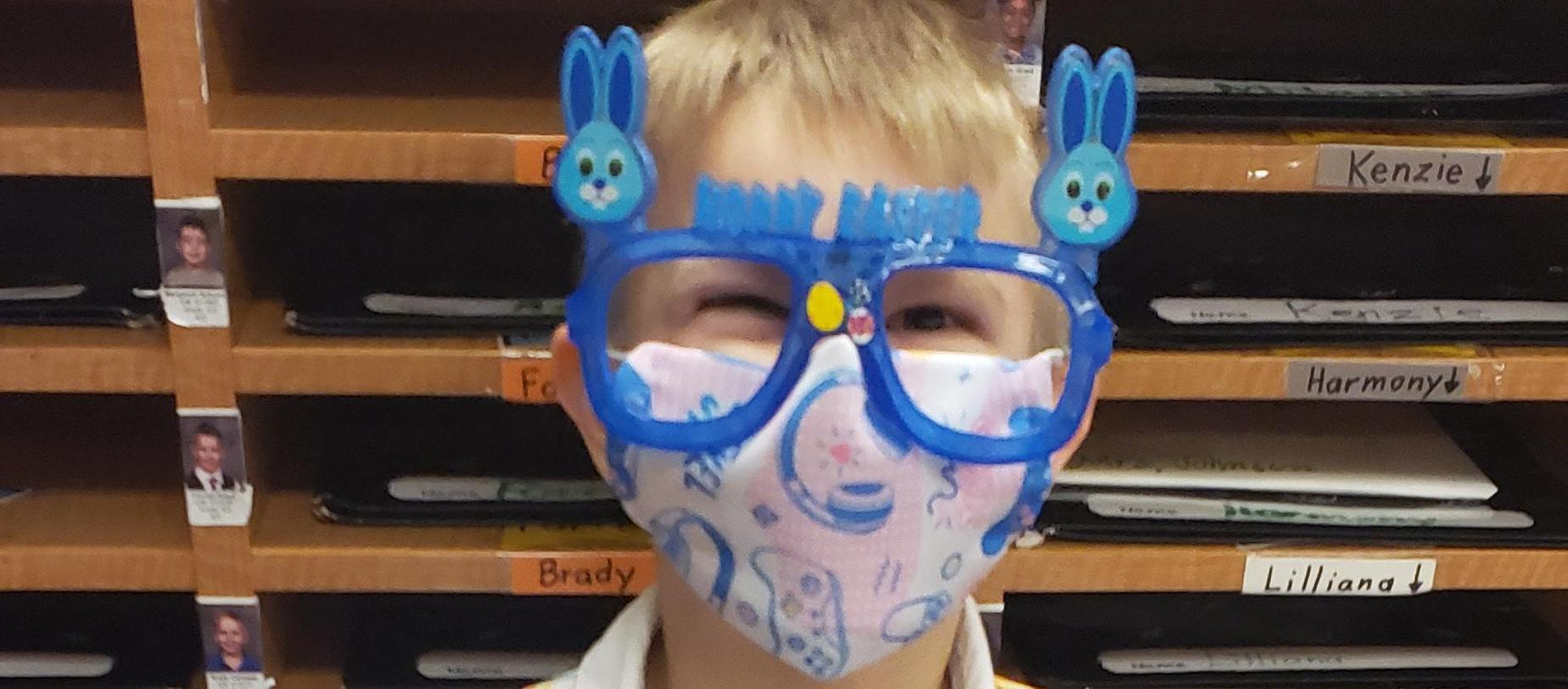 boy wearing bunny sunglasses
