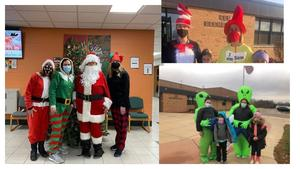 Greeters welcome students as Santa and elves and another week as aliens.