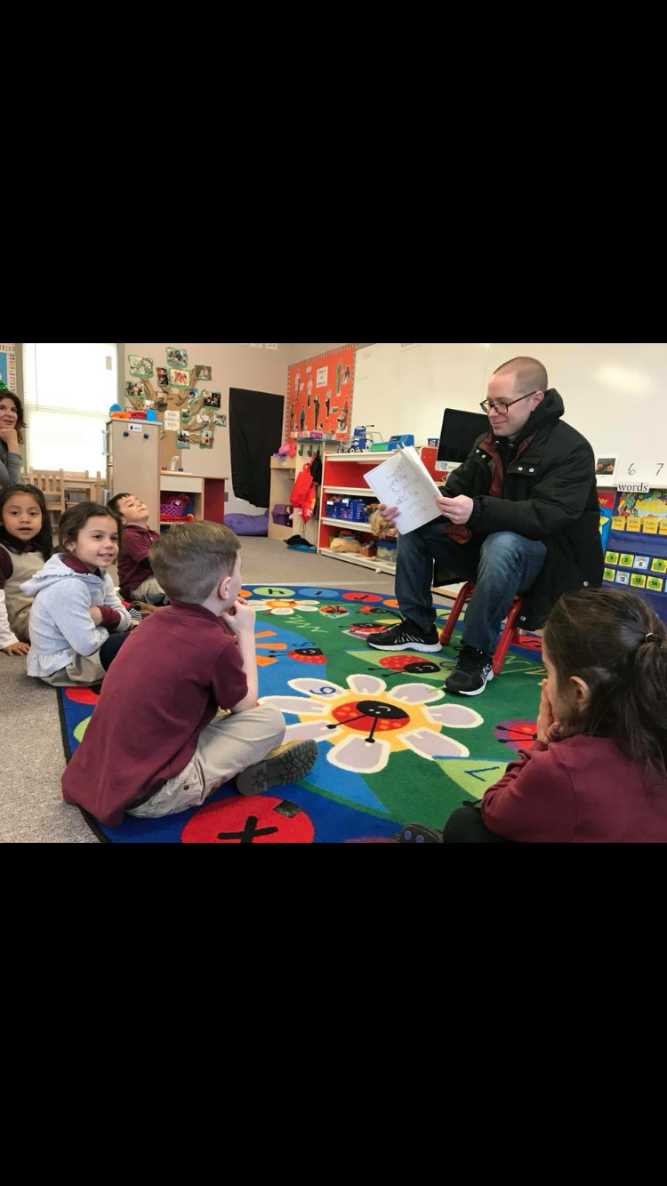 mr sacco reading to the class