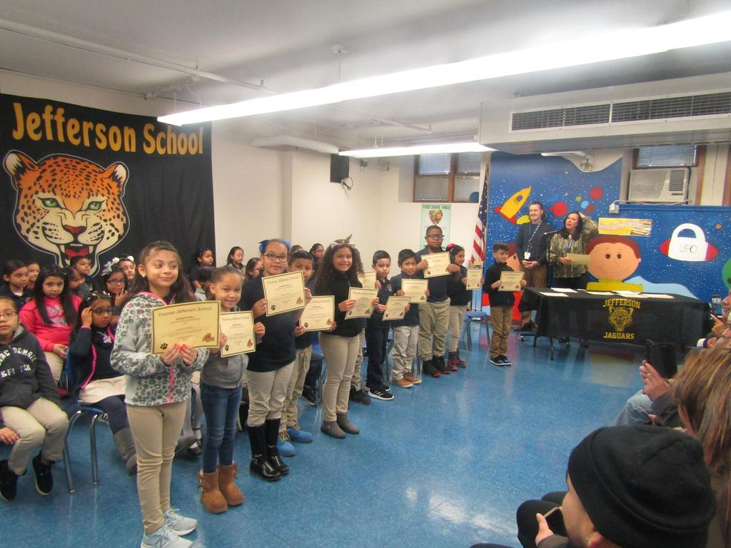 first group of children holding up their certificates