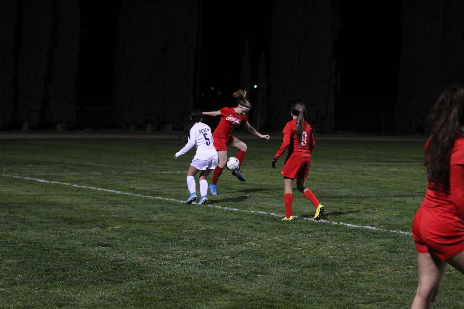 Girls playing soccer