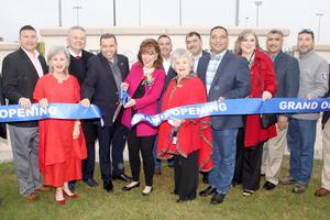 Janet Ogden Vackar cuts the ribbon of the new sports complex named in her honor during the grand opening ceremony in northeast Edinburg.