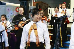 Roosevelt student singing at the performance